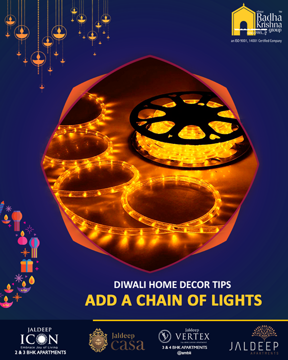 Dazzle up any room with a chain of lights. Instead of just putting up a string, get innovative with a chain of bulbs. Cover the bulbs with colorful cellophane paper!  #DecorTips #ShreeRadhaKrishnaGroup #Ahmedabad #RealEstate #LuxuryLiving