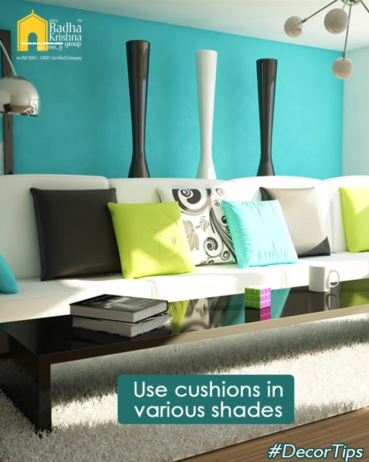 Use cushions in various shades and designs in your living room, to refresh its looks.  #DecorTips #ShreeRadhaKrishnaGroup #Ahmedabad #RealEstate #LuxuryLiving
